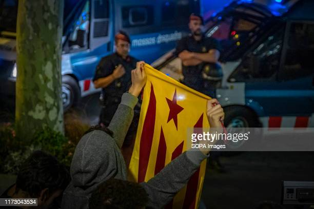 A protester holds a flag for the independence of Catalonia in front of the headquarters of the Delegation of the European Commission of Barcelona...