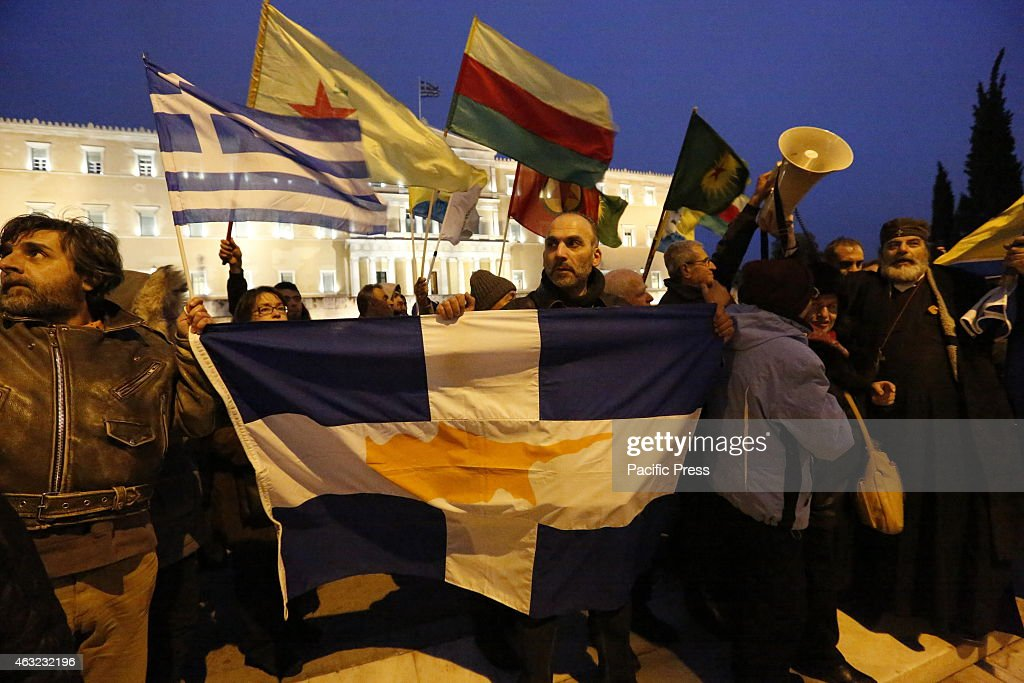 A protester holds a Greek Cypriot flag outside the Greek... : News Photo