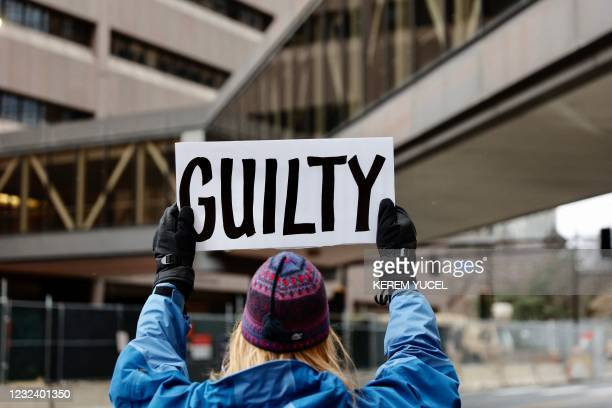 """Protester holds a """"guilty"""" sign outside the Courthouse In Minneapolis, Minnesota on April 19, 2021. - A jury is to hear closing arguments on April..."""