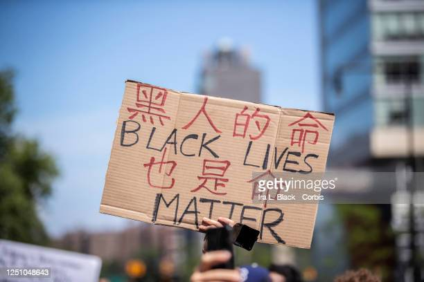A protester holds a homemade sign that says Black Lives Mater and it seems to also be written in Chinese This was in support for Black Lives Matter...