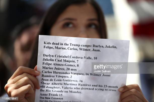 A protester holds a list of all the children that have died during a demonstration against migrant detention facilities on July 2 2019 in San...