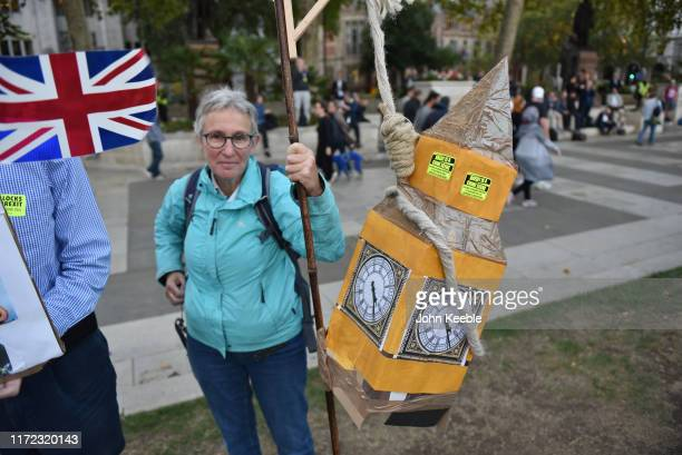 A protester holds a model of Big Ben hanging in a noose as they listen to speakers on Parliament Green outside the Houses of Parliament on September...