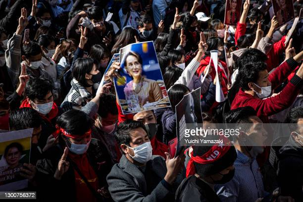 Protester holds a picture of Aung San Suu Kyi during a protest against the military coup, outside the Myanmar embassy on February 07, 2021 in Tokyo,...