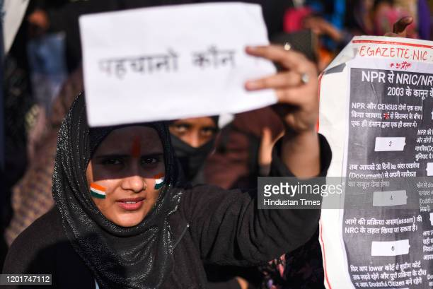Protester holds a placard ahead of the march to Home Minister Amit Shah's residence, at Shaheen Bagh, on February 16, 2020 in New Delhi, India. The...