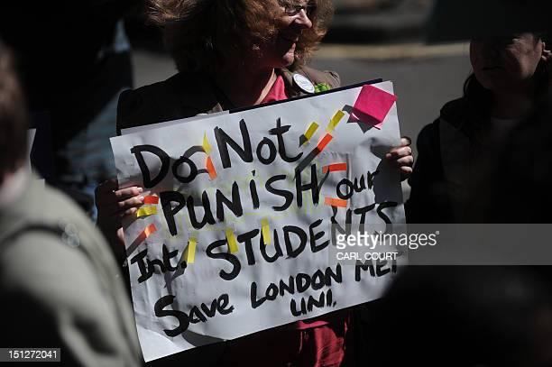 A protester holds a placard as she takes part in a demonstration outside the Home Office in central London on September 5 2012 following the British...