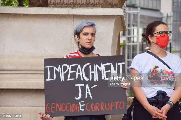 Protester holds a placard calling for the impeachment of Bolsonaro during the demonstration. Protesters gathered at Parliament Square in protest...
