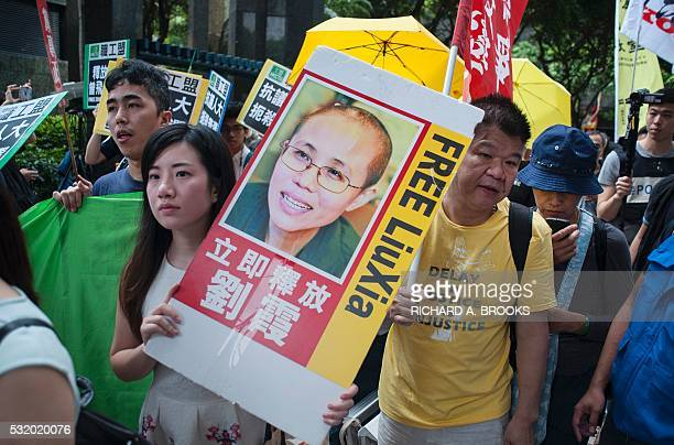 A protester holds a placard calling for the release of Chinese human rights activist Liu Xiaobo as she joins a march in the Wanchai district of Hong...
