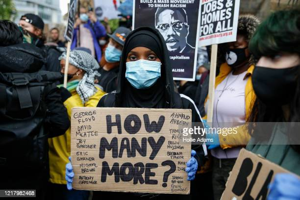A protester holds a placard during a Black Lives Matter demonstration in Parliament Square in central London on June 6 2020 in London United Kingdom...