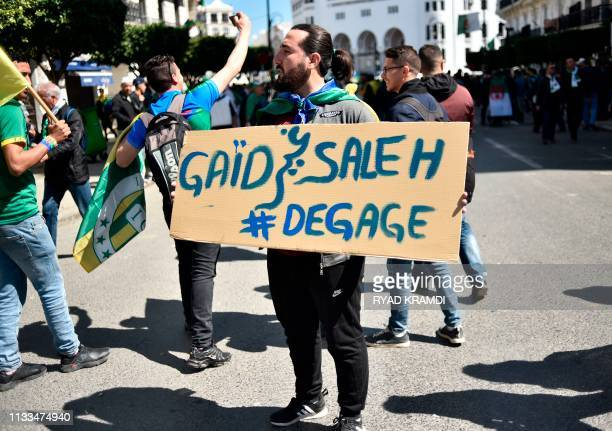 A protester holds a placard during a demonstration against ailing President Abdelaziz Bouteflika in the capital Algiers on March 29 2019 Opposition...