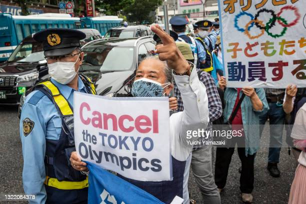 Protester holds a placard during a demonstration against the forthcoming Tokyo Olympic Games on June 06, 2021 in Tokyo, Japan. As Japan endures a...