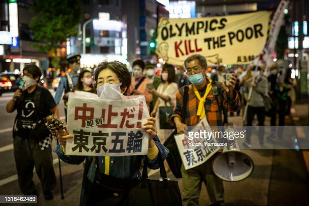 Protester holds a placard during a protest against the Tokyo Olympics on May 17, 2021 in Tokyo, Japan. With less than 3 months remaining until the...