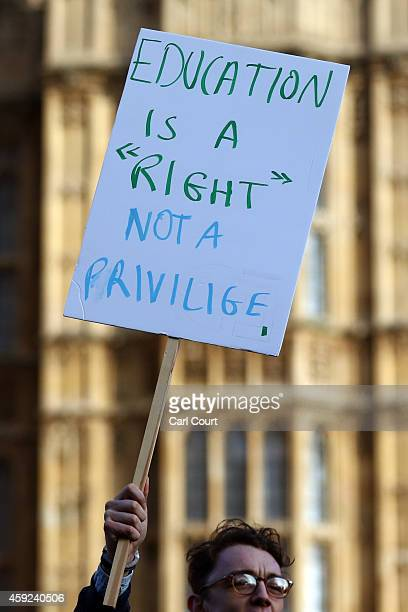 A protester holds a placard during a protest march against fees and cuts in the education system on November 19 2014 in London England A coalition of...