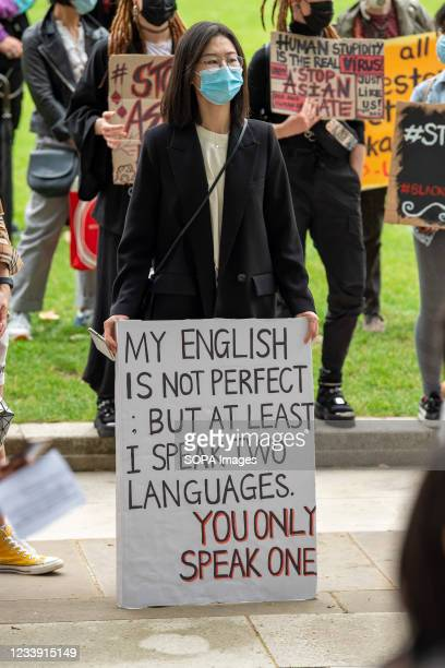Protester holds a placard during a Stop Asian Hate protest at Parliament Square in London. Anti-Asian violence and abuse has escalated since the...