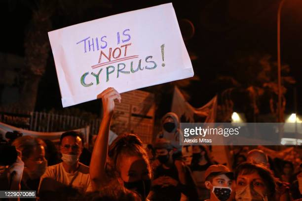 Protester holds a placard during an anti-corruption demonstration on October 14, 2020 in Nicosia, Cyprus. Cyprus has cancelled its citizenship scheme...
