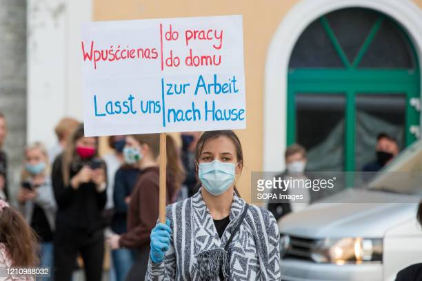 Protester holds a placard during the demonstration. Hundreds of polish-Germany border residents protest against anti-virus measures as they block...
