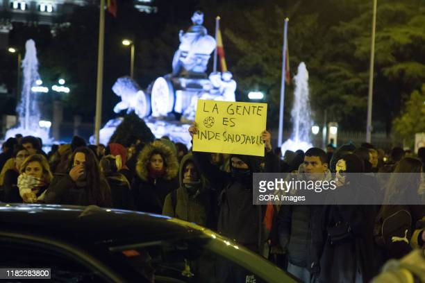 Protester holds a placard during the demonstration. The municipal police evicted without prior notice the self-managed community centre La...