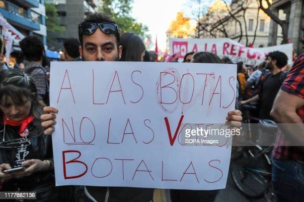 Protester holds a placard during the no to the reform march in Montevideo. People march against the constitutional reform project which proposes a...