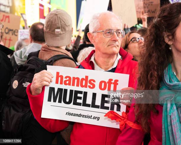 A protester holds a placard during the rally Thousands took to Times Square of New York City during a rally to support Robert Mueller's investigation...