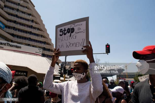 Protester holds a placard during the second day of the #ShutItDown Protests, where hundreds of Namibian youth protested against gender-based violence...