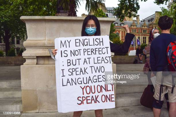 Protester holds a placard expressing her opinion, during the 'Stop Asian Hate' rally in Parliament Square against increasing anti-Asian hate and...