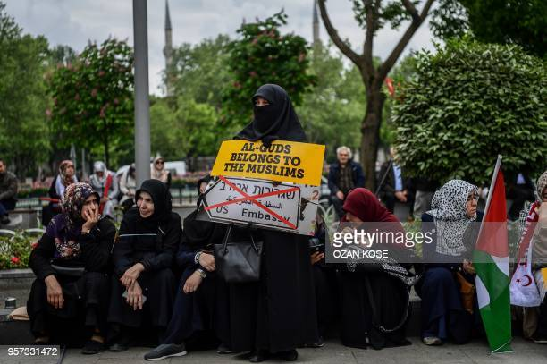 A protester holds a placard reading 'Al Quds belongs to muslims' on May 11 2018 in Istanbul during a demonstration against US President Donald Trumps...