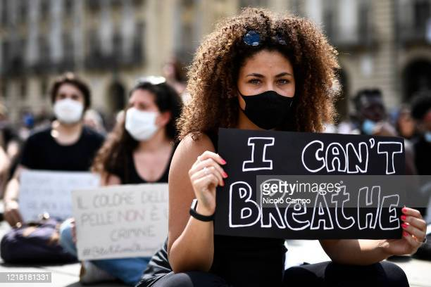 A protester holds a placard reading 'I can't breathe' during a demonstration calling for justice for George Floyd who died May 25 after being...