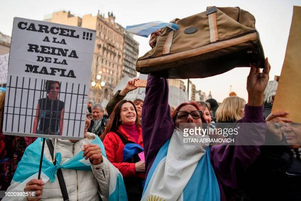 A protester holds a placard reading 'Jail to the Mafia Queen' during a protest in front of the National Congress in Buenos Aires on August 21 2018 to...