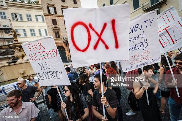 A protester holds a placard reading 'Oki' as he takes part in a rally to support No vote at the upcoming Greek referendum on European Union austerity...