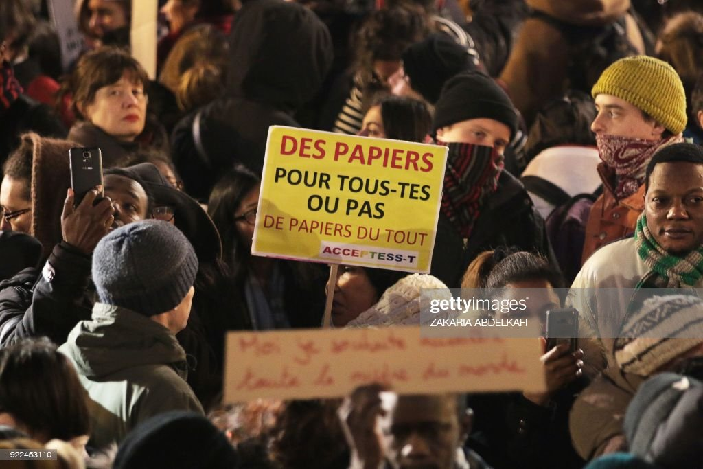 A protester holds a placard reading 'Papers for all or no papers at all ' in Paris on February 21, 2018, during a demonstration against the French government's new immigration bill. The French government defended a new immigration bill as 'completely balanced' on February 21 despite criticism from rights groups and some ruling party lawmakers that it will lead to thousands of extra deportations. The draft law, which criminalises illegal border crossings and speeds up procedures to deport economic migrants, was presented to the cabinet of President Emmanuel Macron for the first time. PHOTO / Zakaria ABDELKAFI