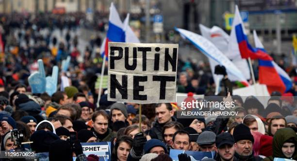 "Protester holds a placard reading ""Putin - No!"" during an opposition rally in central Moscow, on March 10 to demand internet freedom in Russia. -..."
