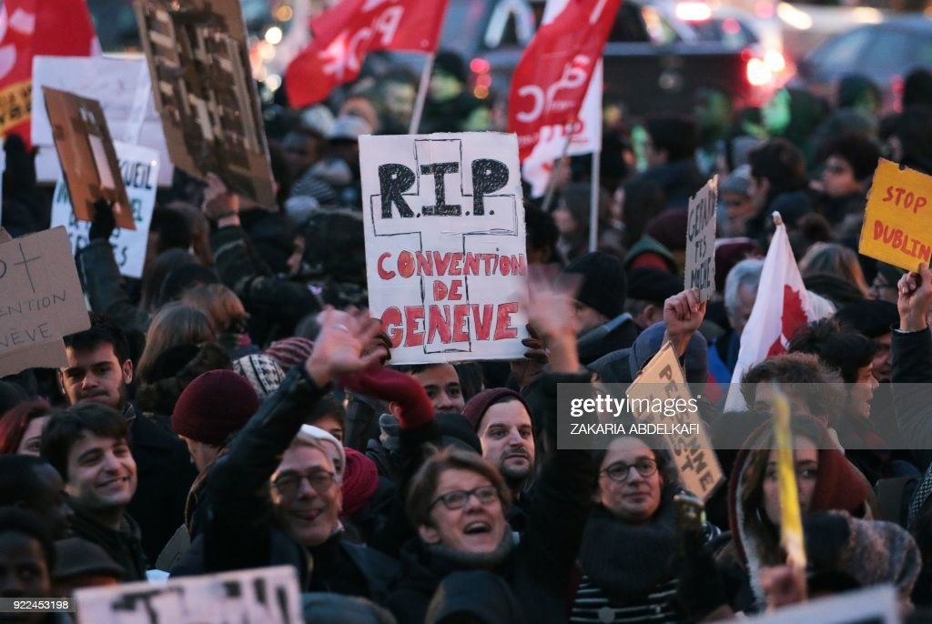 A protester holds a placard reading 'RIP Geneva convention' in Paris on February 21, 2018, during a demonstration against the French government's new immigration bill. The French government defended a new immigration bill as 'completely balanced' on February 21 despite criticism from rights groups and some ruling party lawmakers that it will lead to thousands of extra deportations. The draft law, which criminalises illegal border crossings and speeds up procedures to deport economic migrants, was presented to the cabinet of President Emmanuel Macron for the first time. PHOTO / Zakaria ABDELKAFI