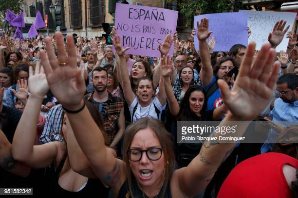 A protester holds a placard reading 'Spain is not a country for women' during a demonstration against the verdict of the 'La Manada' gang case...