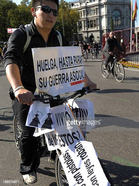 """Protester holds a placard reading """"Strike until we stop they anti-social war"""" during a general strike on November 14, 2012 in Madrid. General strikes..."""