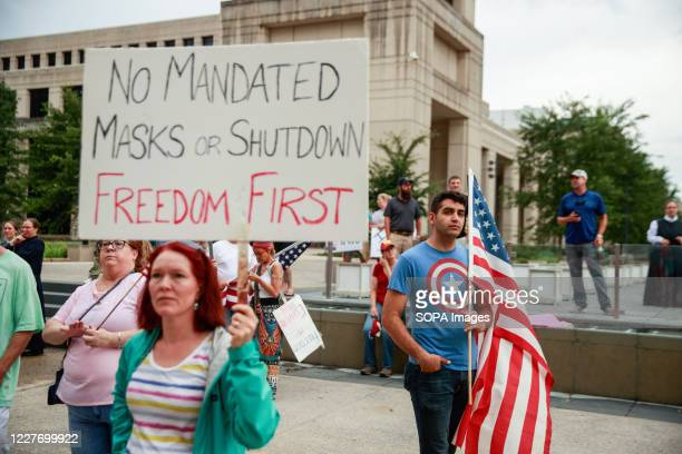 Protester holds a placard saying No Mandated Masks or Shutdown Freedom First during the We Will Not Comply anti mask rally. People protest against...