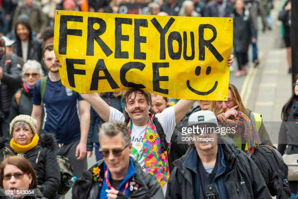 Protester holds a placard that says Free Your face during the demonstration. Activists and people held a demonstration against the current...