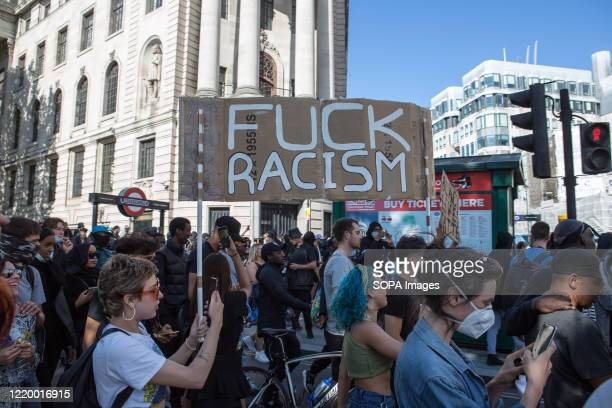 Protester holds a placard that says Fuck Racism during the demonstration. Groups including the far-right activists congregated in the capital,...