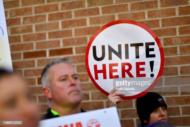 A protester holds a placard while demonstrating with Philadelphia Airport TSA and airport workers outside the Philadelphia International Airport on...