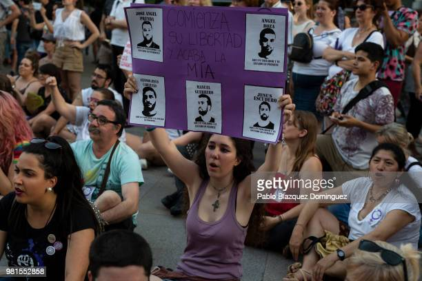 A protester holds a placard with pictures depicting the wolf pack members and reading 'Their freedom starts but mine finishes' during a demonstration...