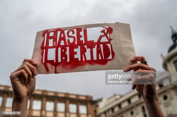 Protester holds a placard with the words 'Freedom Hasel' during a demonstration to protest against the Spanish National Court's decision to sentence...