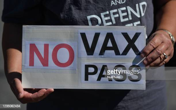 Protester holds a placard with words 'No Vax Pass'. Protesters against vaccines, masks and the pandemic and their supporters seen in Capital Plaza...