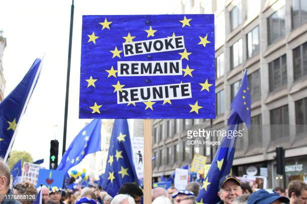A protester holds a placards during the demonstration Brexit march thousands of People's Vote protesters from across the UK have marched through...