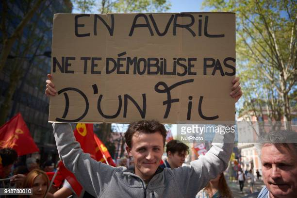 A protester holds a placrdreading 'In April don't demobilize' For the 2nd time more than 7000 protestors take to the streets of Toulouse in a show of...