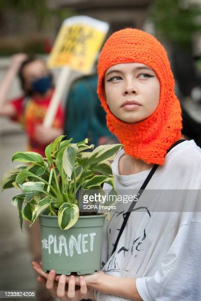 Protester holds a plant with Save the Planet written on the pot during the Kill the Bill protest. Demonstrators gathered in Parliament Square in...
