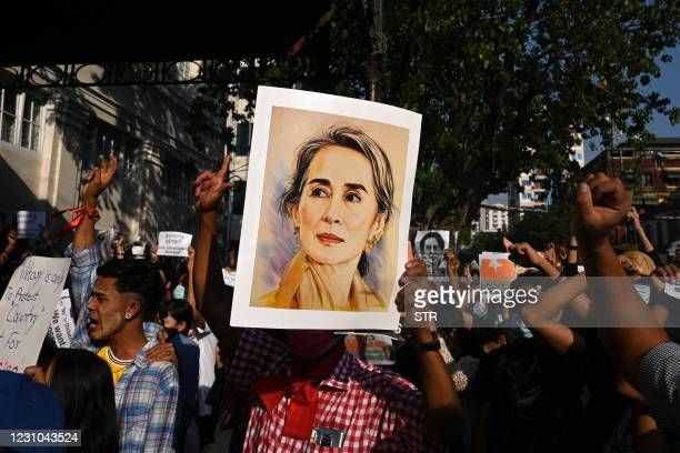 Protester holds a portrait of Aung San Suu Kyi during a demonstration against the military coup in Yangon on February 8, 2021.