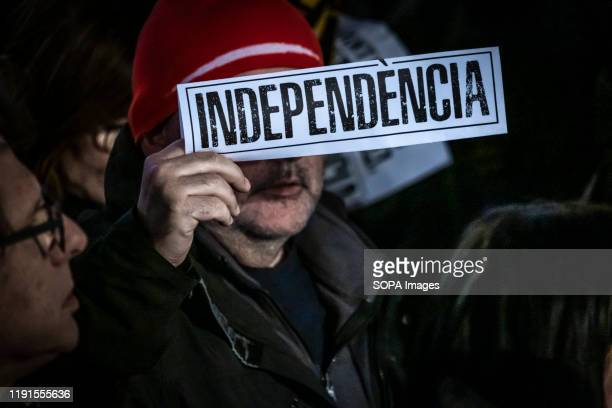 Protester holds a pro independence placard during the demonstration. Hundreds of protesters for the independence of Catalonia have gathered in Plaza...