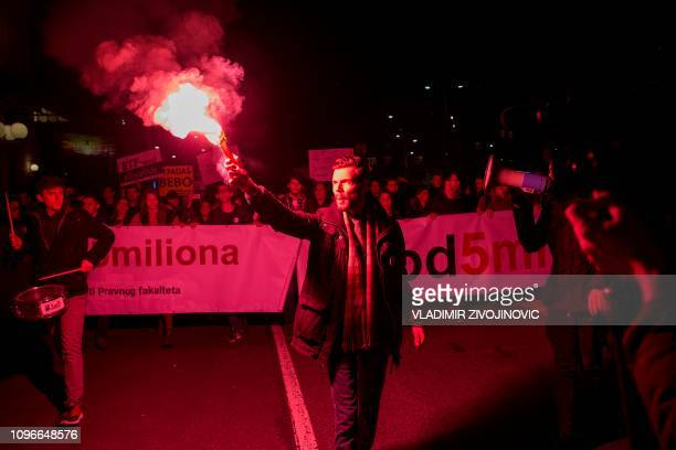 A protester holds a red flare during a demonstration against Serbian President in Belgrade on February 9 2019 Every Saturday thousands of opponents...