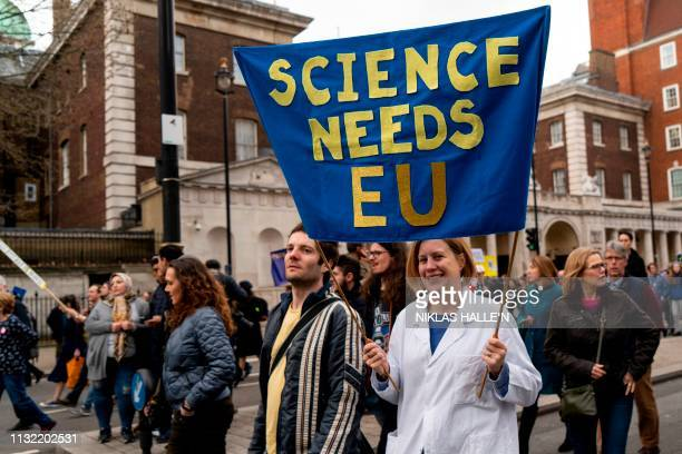 A protester holds a Science needs EU banner on a march and rally organised by the proEuropean People's Vote campaign for a second EU referendum in...
