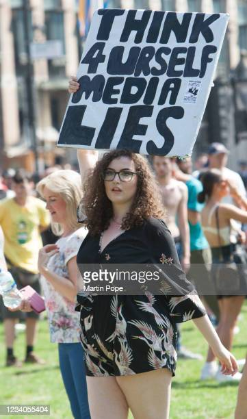 Protester holds a sign accusing the media of lying in Parliament Square as part of a freedom protest on July 19, 2021 in London, England....