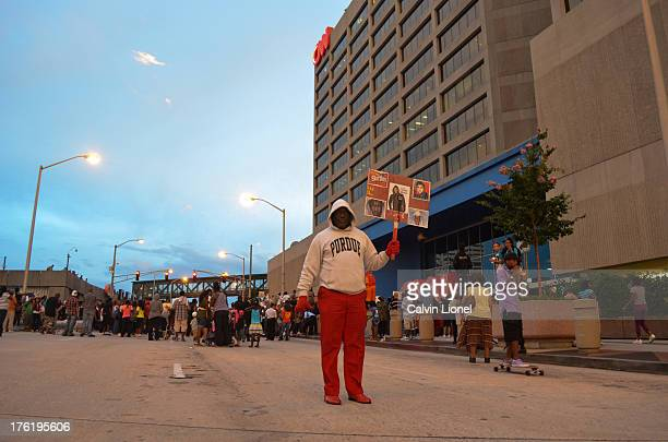 Protester holds a sign as demonstrators gather at the CNN Center in downtown Atlanta, Georgia in protest of the acquittal of George Zimmerman who...
