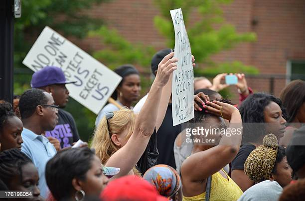 Protester holds a sign as demonstrators gather at the Sankofa Church of Christ in downtown Atlanta, Georgia in protest of the acquittal of George...